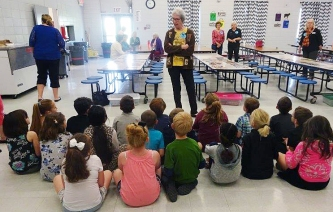 Ginger Malmstrom pictured here with first grade class in Huntsville, AR.